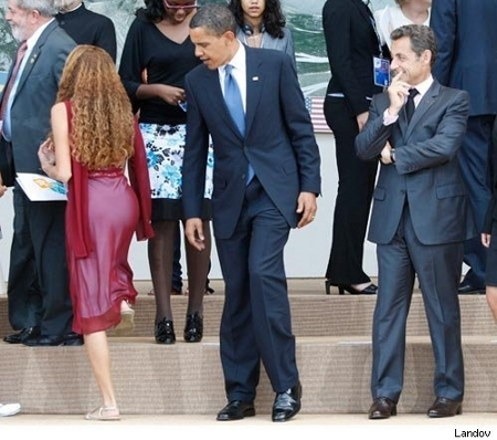 Obama supposedly checking the very shapely ass of a 16 year-old Brazilian girl