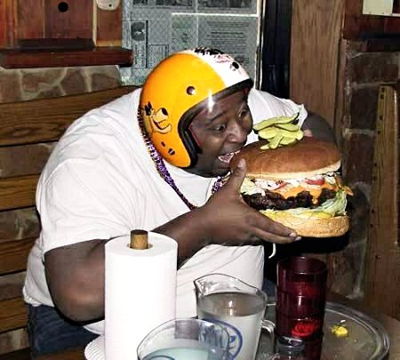 Fat Black Fool Gorging On A Giant Burger