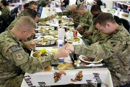Soldiers at Thanksgiving dinner