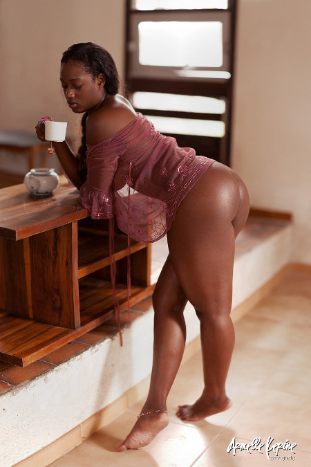 A fine, thick negress enjoying a hot cuppa