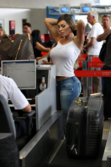 woman strips for airport security