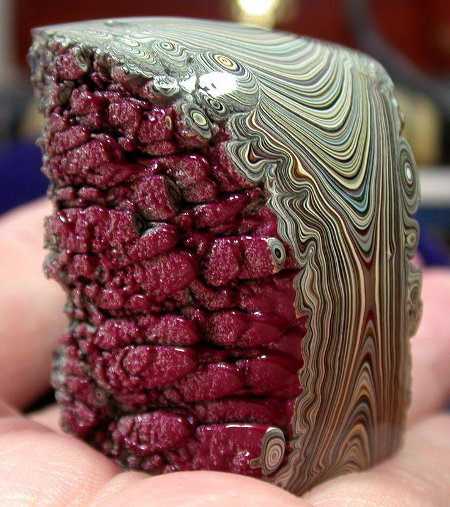 Lies!  The rock is a lie! It's paint. Specifically, it's mixture of many automotive paints aged for years known as Fordite